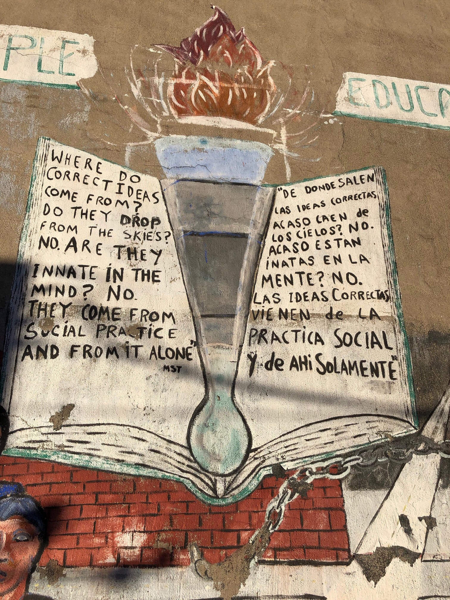 public wall art with statement handwritten about ideas coming from social practices